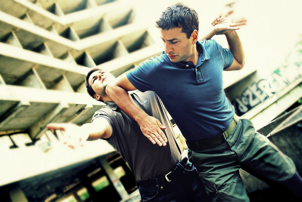 two men fighting as legal self-defence