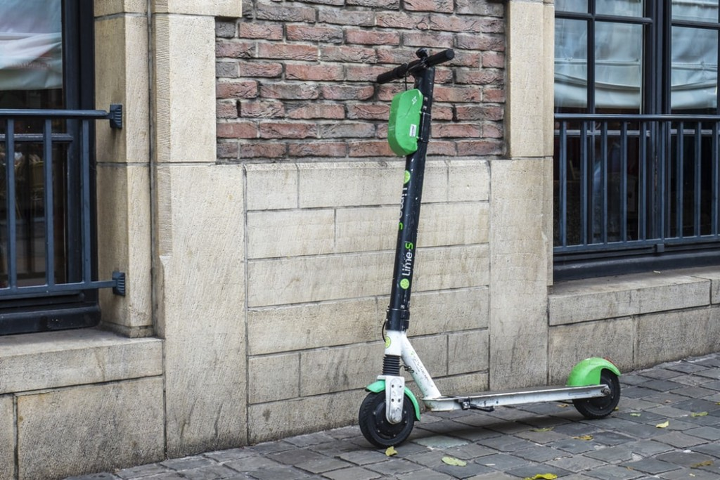 electronic scooter by the wall