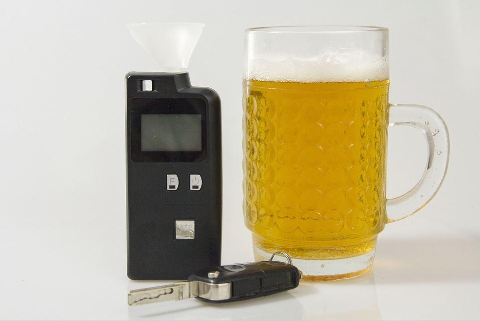 breathalyzer, beer glass and car key