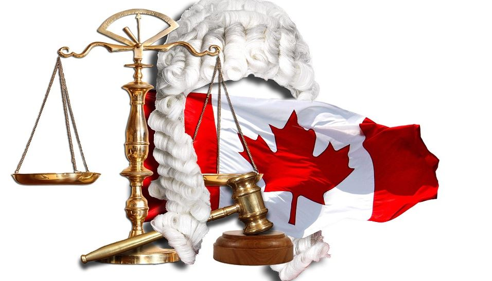 scale, gavel and Canadian flag
