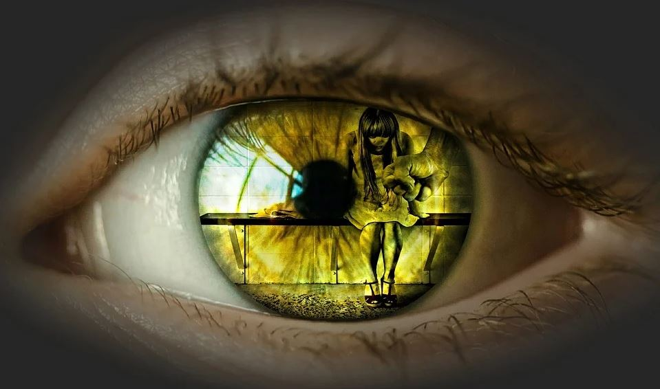 eye with reflection of small girl in iris