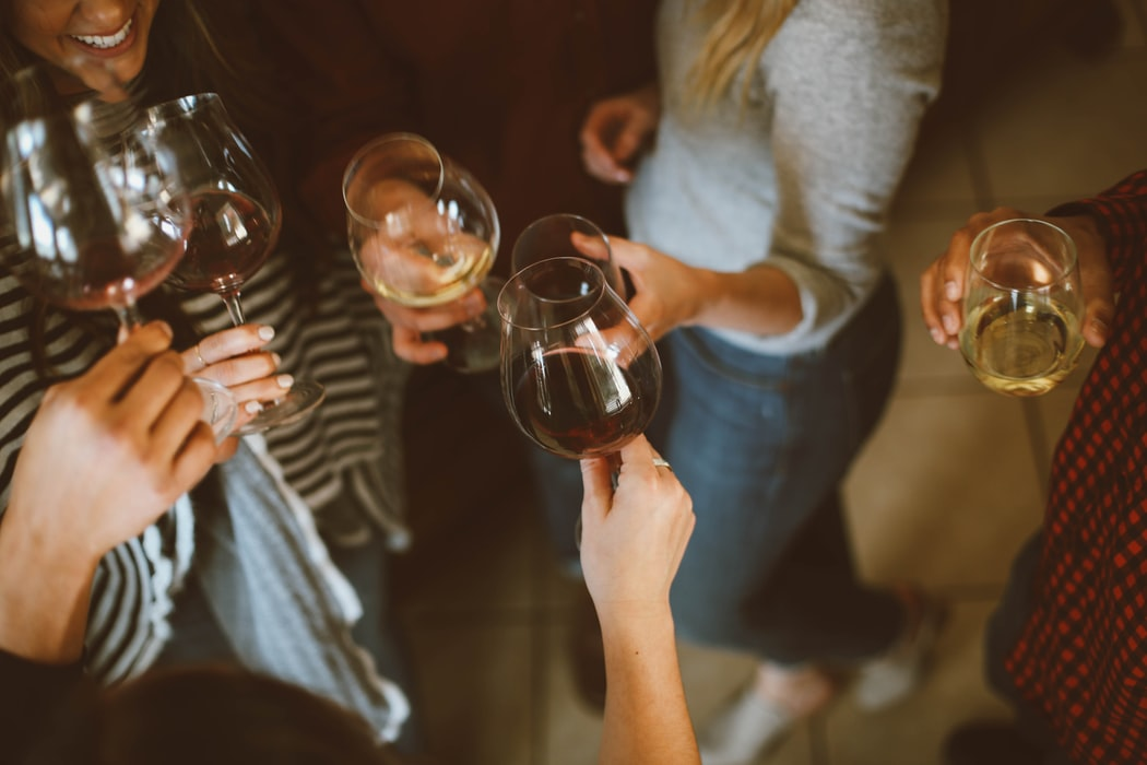 group-of-people-tossing-wine-glasses