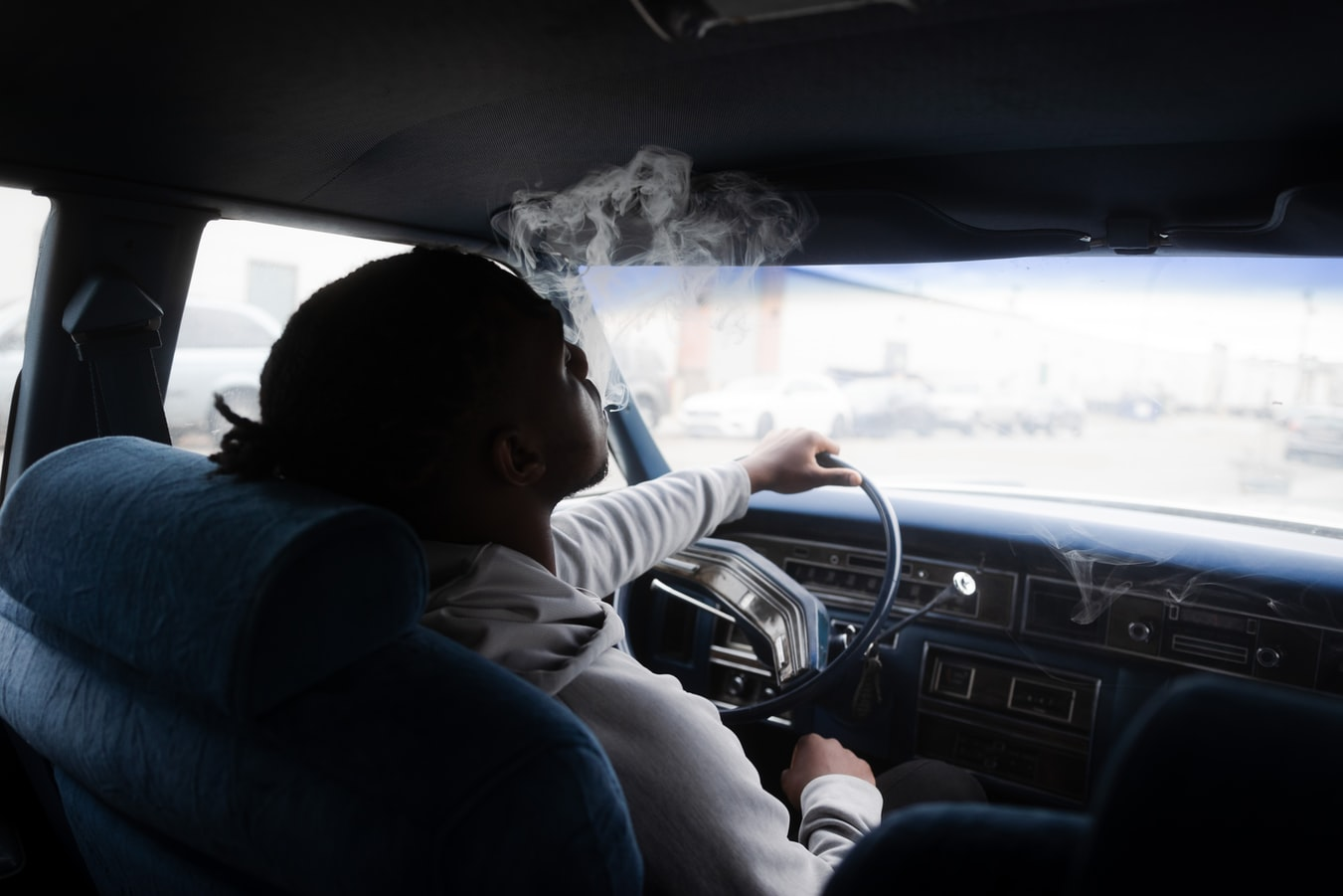 man-driving-and-smoking