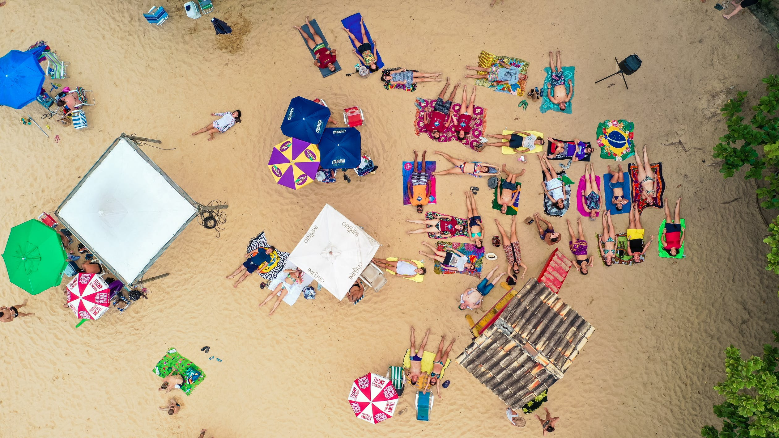people-lying-on-the-sand